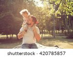 piggyback of baby and dad | Shutterstock . vector #420785857