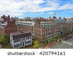 Aerial view on John F Kennedy Street in Harvard University Area in Cambridge, Massachusetts, the USA. Eliot House white belltower seen on the background. Tourists in the street