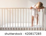 portrait of bored baby standing ... | Shutterstock . vector #420817285