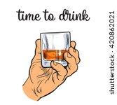hand holding a full glass of...   Shutterstock .eps vector #420862021