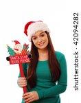 Happy Girl Holding Santa Stop...