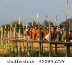 Small photo of MAE HONG SON, THAILAND - NOVEMBER 21, 2015: Morning Buddhist Almsgiving at Zu Tong Pae bamboo bridge in Mae Hong Son, Thailand. Monks go on a daily almsround to collect food.
