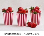 Strawberries In A Striped Cups...