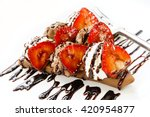 chocolate strawberry crepe  | Shutterstock . vector #420954877