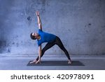 young man practicing yoga | Shutterstock . vector #420978091