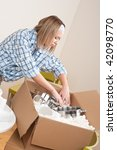 moving house  woman unpacking... | Shutterstock . vector #42098770