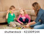 children and their mother are... | Shutterstock . vector #421009144