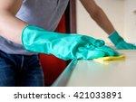 man's hand holding a yellow rag ... | Shutterstock . vector #421033891