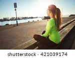 sporty woman resting after... | Shutterstock . vector #421039174