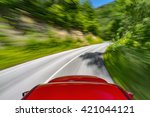 car driving on a winding road | Shutterstock . vector #421044121