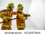 Fireman  Attacking A Fire With...
