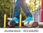 Children's Feet In Sneakers An...