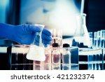 flask in scientist hand with... | Shutterstock . vector #421232374