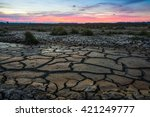 land with dry and cracked ground | Shutterstock . vector #421249777