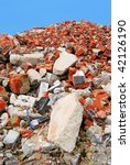 Pile of brick stone waste of a demolished building - stock photo