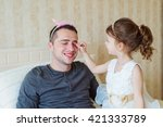 cute girl putting on make up on ... | Shutterstock . vector #421333789