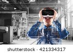 Stock photo man wearing virtual reality goggles we 421334317