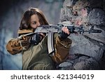 girl styled as a soldier aims...