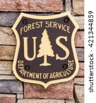 Small photo of ACTON, CA/USA - MAY 7, 2016: United States Forest Service sign and logo. The United States Forest Service (USFS) is an agency of the U.S. Department of Agriculture.