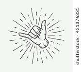 Vintage surfing shaka hand with retro sunburst. Graphic vector illustration.  | Shutterstock vector #421376335