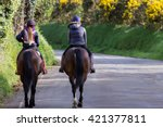 Two Young Woman Riding Horses...