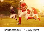 Small photo of American football game - out of focus background of the field