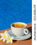 White Cup Of Coffee Near Pool...
