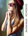 Small photo of Young pretty woman in 3d glasses looking in amazement surprised. Beautiful amazing elegant romantic female portrait closeup