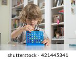 litlte boy playing four in a... | Shutterstock . vector #421445341