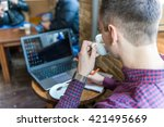 a young man with a laptop and a ...   Shutterstock . vector #421495669