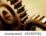 closeup of two metal cog gears | Shutterstock . vector #421509781