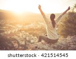carefree happy woman sitting on ... | Shutterstock . vector #421514545