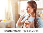 pleasant  woman eating maffyn | Shutterstock . vector #421517041