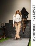 model walks the runway for the...   Shutterstock . vector #421529317