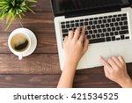 hand using laptop computer on... | Shutterstock . vector #421534525