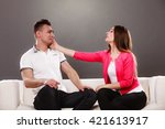husband and wife sitting on... | Shutterstock . vector #421613917