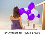 girl sitting and holding a lot... | Shutterstock . vector #421617691