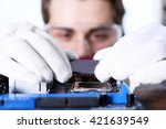 man fixing electronic circuits... | Shutterstock . vector #421639549