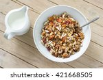 homemade muesli and milk in a... | Shutterstock . vector #421668505