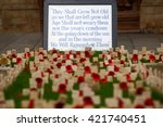 "Small photo of "" Lest we forget "" reminder for Remembrance Day for fallen soldiers with poppies in front of the Bath Abbey, Bath, Somerset, England"