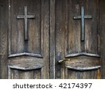 An Old Wood Door With Metal...