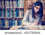 Small photo of Maths against woman studying in the library