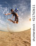 beach soccer player in action.... | Shutterstock . vector #421763611
