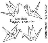 hand drawn line paper crane set....   Shutterstock .eps vector #421766869