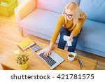 happy  young woman paying bills ... | Shutterstock . vector #421781575