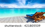 deckchairs on jetty in front of ... | Shutterstock . vector #421805539