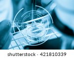 hands of clinician holding... | Shutterstock . vector #421810339