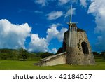 Old Stone Windmill Sits In A...