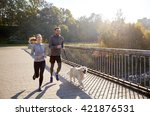 Stock photo fitness sport people and jogging concept happy couple with dog running outdoors 421876531
