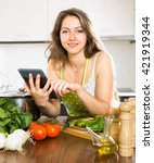 woman reading recipes with a... | Shutterstock . vector #421919344